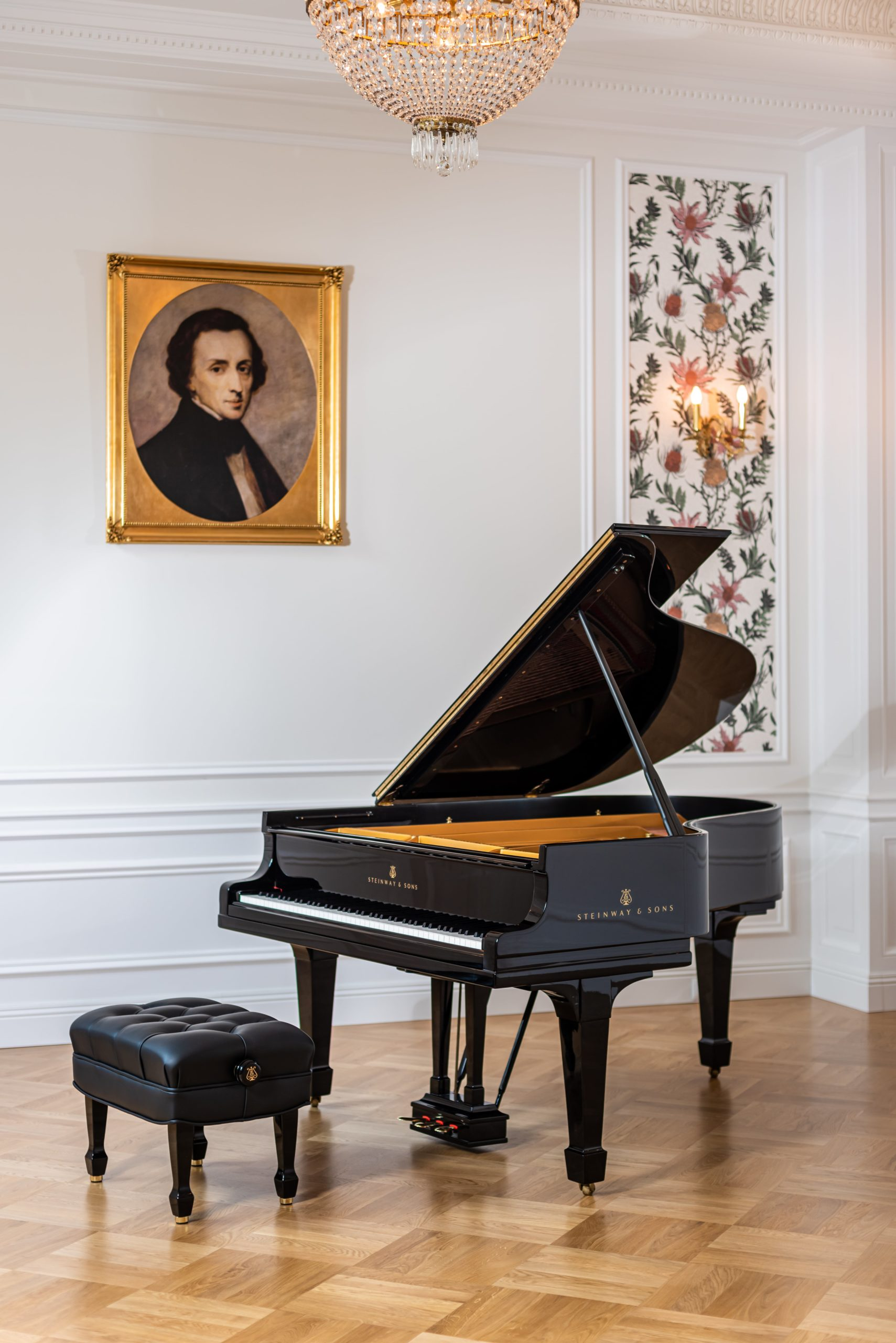 Chopin portrait hanging over the black piano at Fryderyk Concert Hall